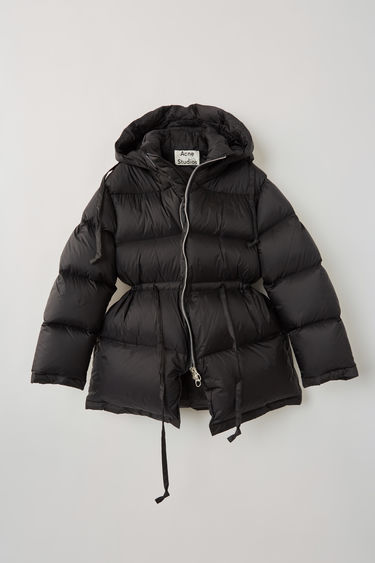 Acne Studios black down jacket is made from a nylon shell and equipped with a two-way zip and padded hood.This style is designed for an oversized fit. We recommend taking a size smaller.