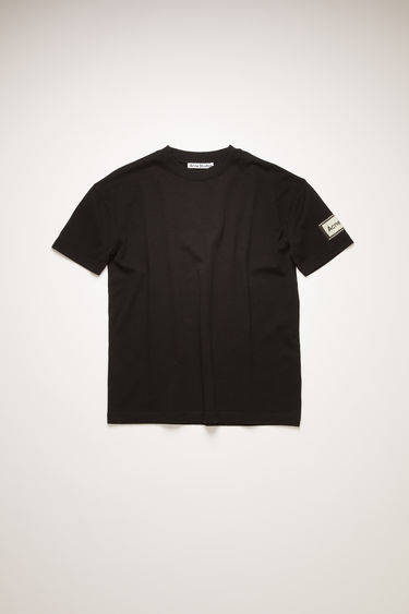 Acne Studios black t-shirt is crafted from organic cotton to an oversized silhouette and adorned with a label patch on the sleeve.