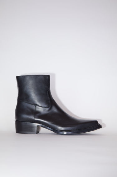 Acne Studios black ankle boots are made of calf leather with pointed toes and zipper closures.