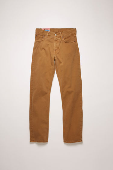 Acne Studios 1996 Caramel Twill jeans are ccrafted from cotton twill that's garment dyed to add softness and give a lived-in appeal. They're shaped to a high-rise silhouette before falling into loose, straight legs.