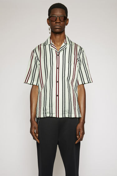 Acne Studios pastel green/burgundy shirt is crafted from a lightweight cotton and viscose blend with a cuban collar and patterned with multicoloured stripes.