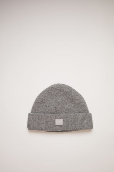 Acne Studios grey melange beanie is knitted with wool and lycra for a closer fit and accented with a tonal face-embroidered patch on front.