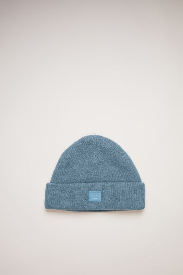 Acne Studios mineral blue beanie is knitted with wool and lycra for a closer fit and accented with a tonal face-embroidered patch on front.