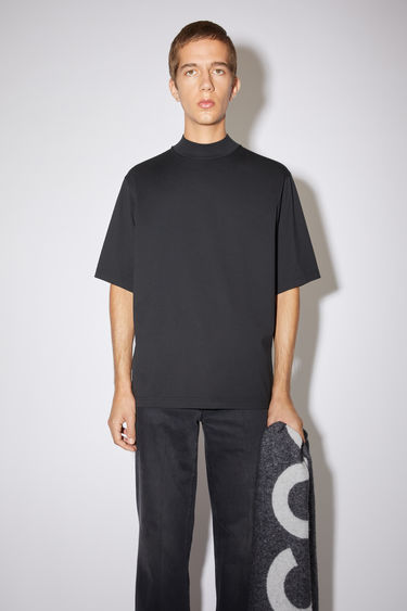 Acne Studios black t-shirt is cut to a boxy fit from soft cotton jersey and shaped with a mock neck and short sleeves.