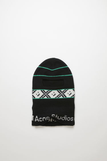 Acne Studios black multicolour wool balaclava is knitted with a jacquard design of the house's logo and face motif and features an opening for the eyes and nose and side opening for a comfortable fit.