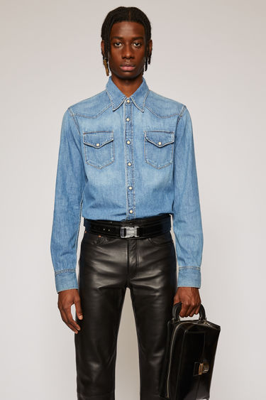 Acne Studios 2001 Mid Blue Trash denim shirt is crafted to a slim silhouette with V-shaped yokes outlined in Western-style brown topstitching, and finished with antiqued metal press-stud closures.