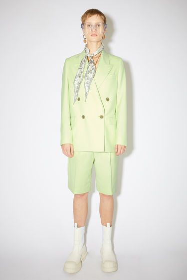 Acne Studios lemon yellow double-breasted suit jacket is made of a wool blend with a classic fit.