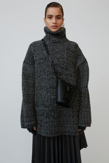 Acne Studios grey/dark grey sweater is crafted from wool in rib-knit and shaped with a roll neck and dropped shoulders.