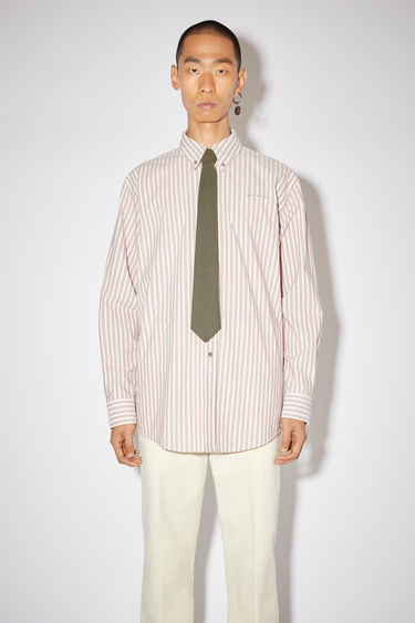 Acne Studios old pink long sleeve shirt is made of striped cotton with a logo at the chest.
