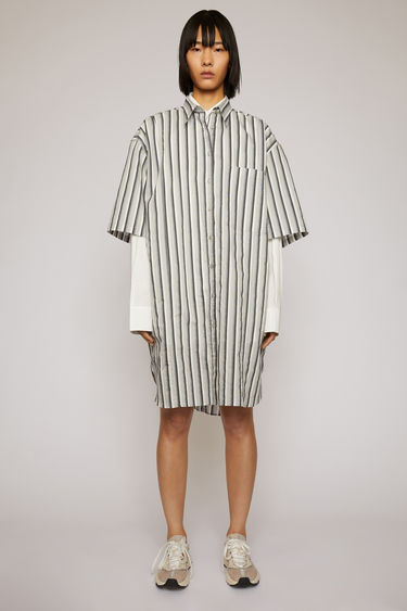 Acne Studios platinum grey shirt dress is crafted from a lightweight cotton-blend to an oversized fit and patterned with vertical stripes.