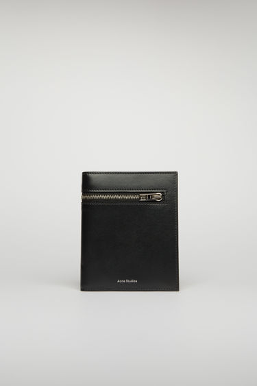 Acne Studios black trifold wallet is crafted from smooth leather and fitted with zip pockets, receipt partitions and card slots.