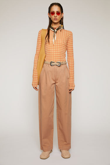 Acne Studios old pink trousers are cut from cotton twill to a straight-leg silhouette and finished with a pleated waist band.