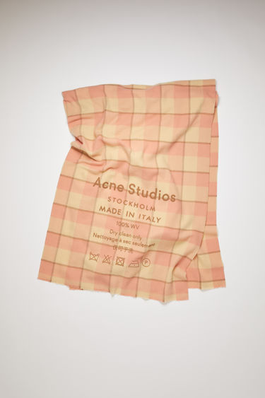 Acne Studios wheat beige/pink scarf is crafted from wool that's twill-woven in a classic shepherd's check pattern and emblazoned with a large-scale printed logo and care instruction.