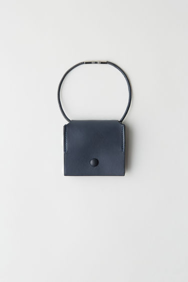 Acne Studios dark blue coin purse is a snap button purse with a thin, removable leather shoulder strap.