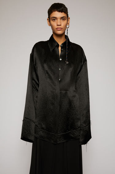 Acne Studios black satin shirt is crafted to an oversized fit with dropped shoulder seams and purposefully finished with raw, frayed edges along the collar, cuffs and hem.