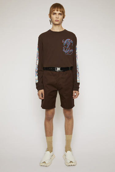 Acne Studios coffee brown shorts are tailored from durable cotton-canvas to a straight-leg shape and finished with a five pocket construction.