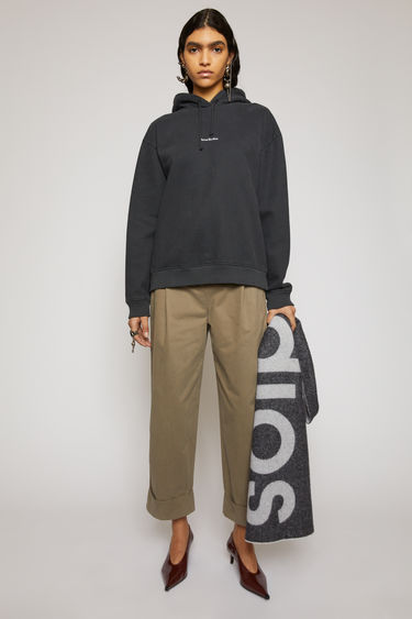 Acne Studiod chino trousers are tailored with a high-rise waist stitched with pleats and lead loosely into cropped, straight legs with turn up hems.
