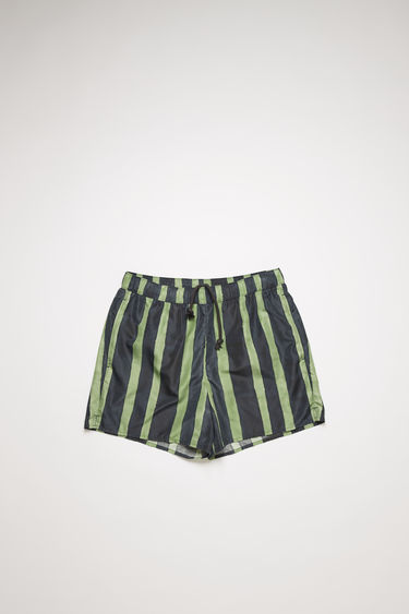 Acne Studios navy/green swim shorts are crafted from technical nylon with front and back pockets and patterned with vertical stripes.