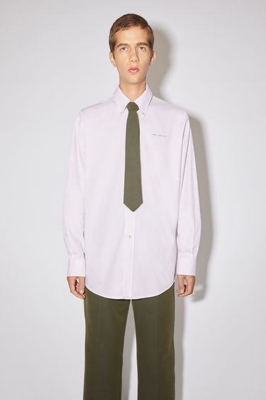 Acne Studios white/pink long sleeve shirt is made of subtly checked cotton with a logo at the chest.