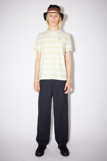 Acne Studios pale green cotton jersey t-shirt features pastel stripes and an embroidered face patch.