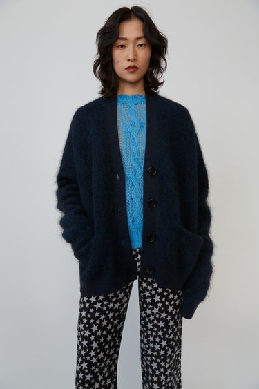 Acne Studios Rives Mohair deep petrol cardigan is shaped to a loose silhouette with dropped shoulders and finished with ribbed trims.
