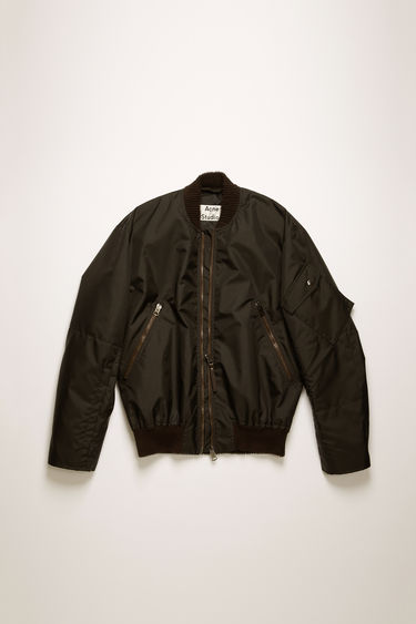Acne Studios black bomber jacket is crafted from technical nylon shell with padding and features corduroy ribbing on the neck, zip guard and hem.