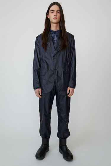 Jace Ny Rip navy blue is a nylon suit jacket with classic details.