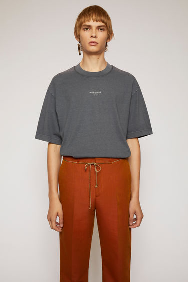 Acne Studios slate grey t-shirt is cut from midweight cotton jersey to a boxy silhouette and then accented with a reversed logo across the chest.