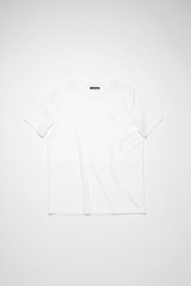 Acne Studios optic white crew neck t-shirt is made of organic cotton with a face logo patch and ribbed neckline.