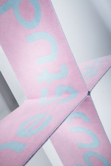 Acne Studios light blue/pink oversized scarf is made of a soft recycled wool blend featuring bold, contrasting logo lettering on both sides.