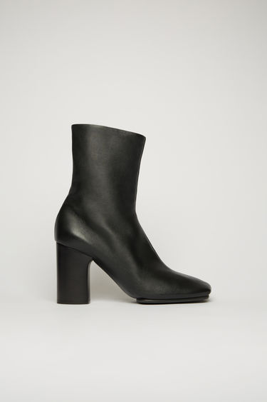 Acne Studios black ankle boots are crafted from soft lamb leather to a square-toe shape and set on a high block heel and durable rubber sole.