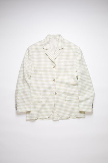 Acne Studios green/grey single-breasted suit jacket is made of a cotton blend tweed with an oversized fit.
