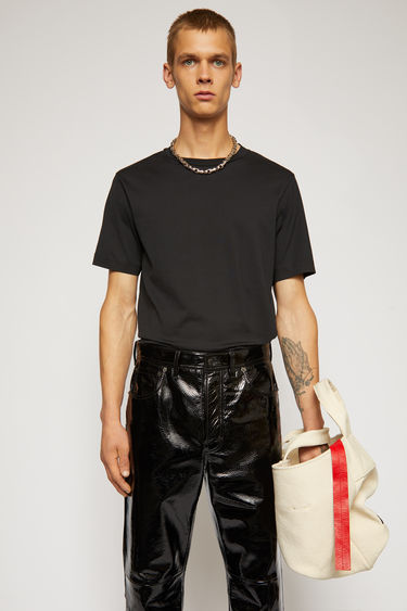 Acne Studios black t-shirt is cut to a slim fit from soft cotton jersey and completed with a ribbed crew neck and short sleeves.