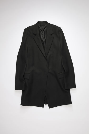 Acne Studios black double-breasted coat is made of a wool blend with hidden closures.