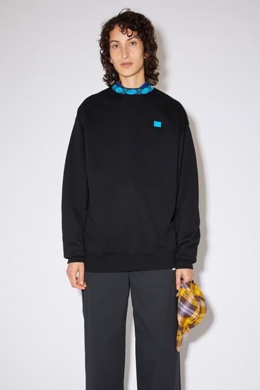 Acne Studios black/blue oversized sweatshirt is made of brushed fleece with ribbed details and a face logo patch at the chest.