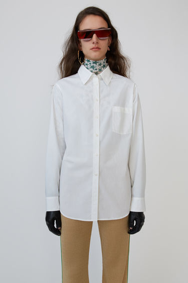 Acne Studios white classic shirt is made from cotton and accented with a logo embroidery.