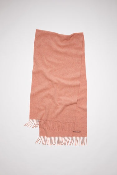 Acne Studios Canada Nr New rose melange scarf is crafted from pure wool and finished with fringed edges and a label across one corner.