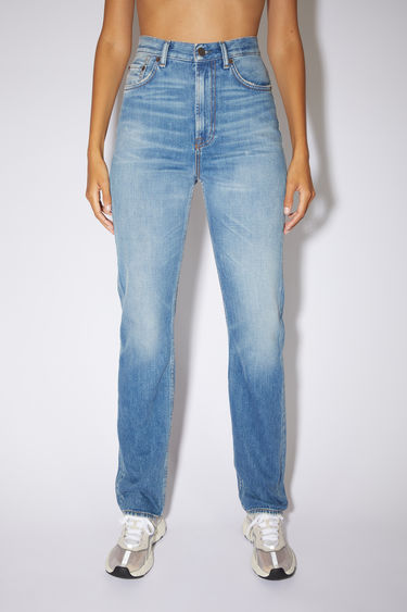 Acne Studios mid blue jeans are made from rigid denim with a high rise and a slim, straight leg.