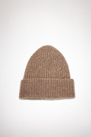 Acne Studios mink brown rib knit beanie hat is made of a cashmere blend with an upturned edge.