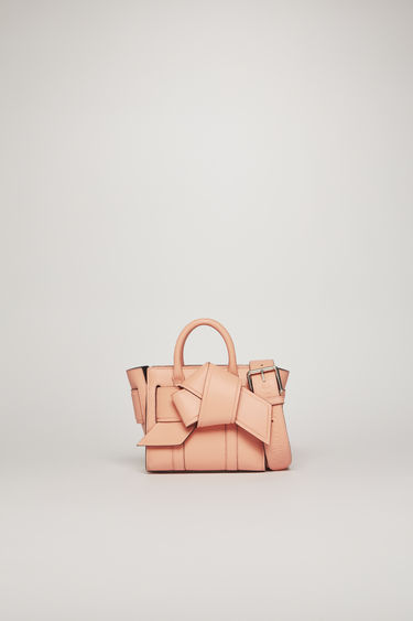 Acne Studios launches a collection of bags and accessories with Mulberry. The Micro Musubi Bayswater bag is crafted from soft calf leather with a debossed co-branded logo and has a knotted strap wrapped around the sides.