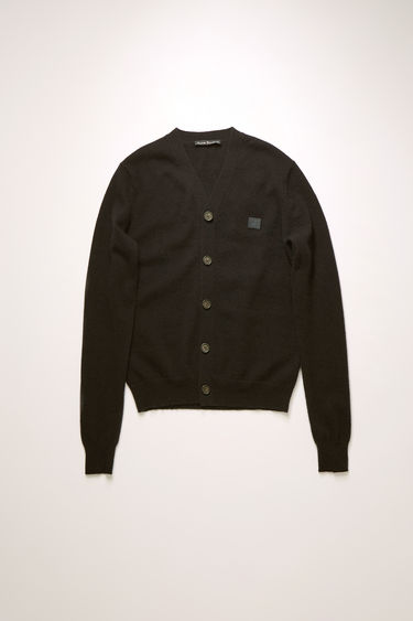 Acne Studios black cardigan is knitted in a fine gauge from soft wool yarns and accented with a tonal face-embroidered patch on the chest.