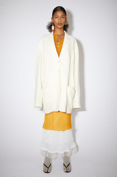 Acne Studios ivory white oversized, single-breasted suit jacket with two front pockets.