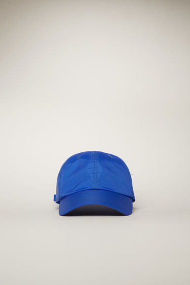 Acne Studios electric blue cap is shaped to a six-panel silhouette and completed with a face-embroidered patch on the back.