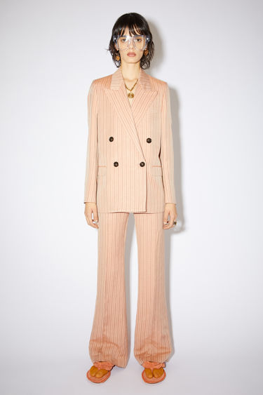 Acne Studios pink/brown double-breasted suit jacket is made of a striped linen blend with a classic fit.