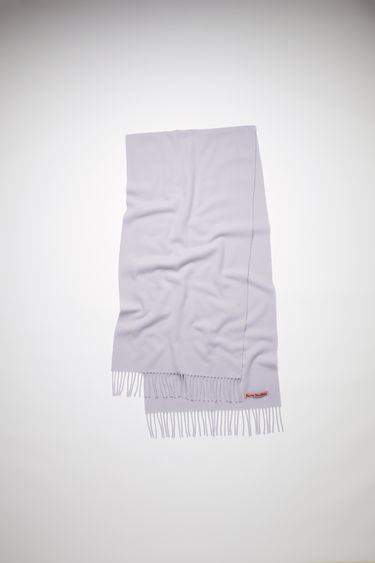 Acne Studios cold lilac narrow fringed scarf is made of pure wool, featuring a label in one corner.