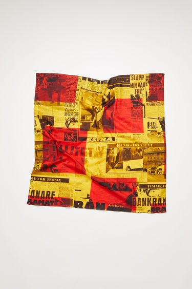 Acne Studios red/yellow scarf is made of cotton, featuring a Stockholm Syndrome newspaper print.