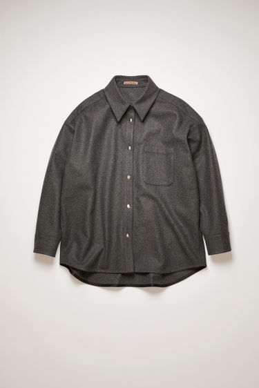 Acne Studios charcoal grey flannel overshirt is cut generously through the body with dropped shoulders and crafted with a neat, point collar, front patch pocket and silver snap buttons.