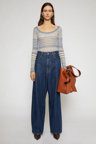 Acne Studios dark blue jeans are crafted from soft tencel-blend denim that's stonewashed to give a worn-in appeal. They're shaped with a high-rise waistband, dropped crotch and loose, wide legs for a roomy and relaxed fit.