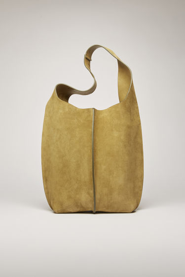 Acne Studios moss green tote bag is crafted from supple suede and has a silver-tone metal clasp which opens to reveal a spacious logo-embossed leather lining with a detachable zip pouch.