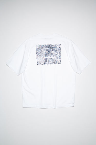 Acne Studios optic white cotton jersey t-shirt features a rhinestone face at the chest and diamond print on the back.